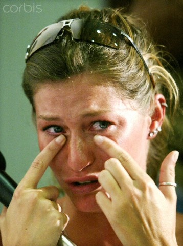 Original caption: Brazilian supermodel Gisele Bundchen wipes away tears while discussing her career during a press conference at an arts school in Salvador, Bahia, February 28, 2003. Bundchen is in Salvador to celebrate Carnival, which runs until March 4. REUTERS/Paulo Whitaker --- Image by © Reuters/CORBIS